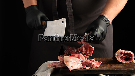 chef in black latex gloves holds