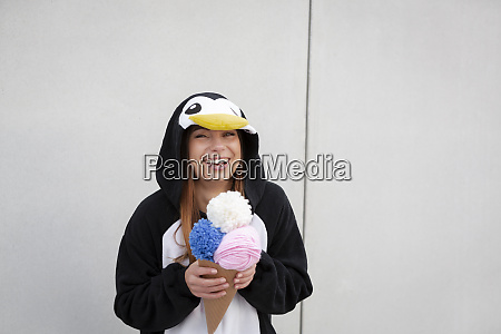 beautiful young woman in penguin costume