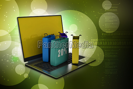 laptop with shopping bag