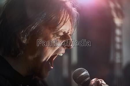 metal singer on stage screaming