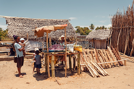 malagasy woman on street sell firewood