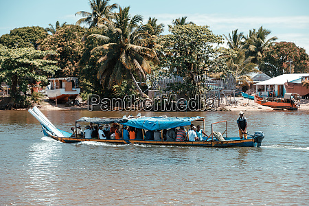 overloaded and crowded taxi boat madagascar