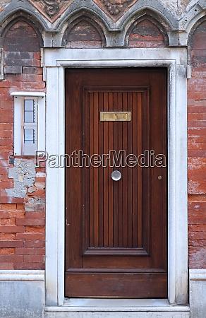 door on brickwall facade