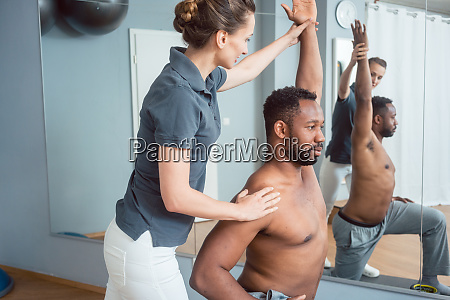 young man receiving physical therapy after