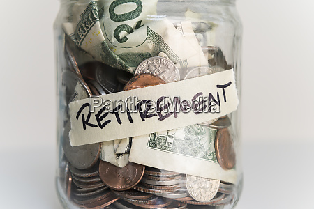 money in jar labeled retirement