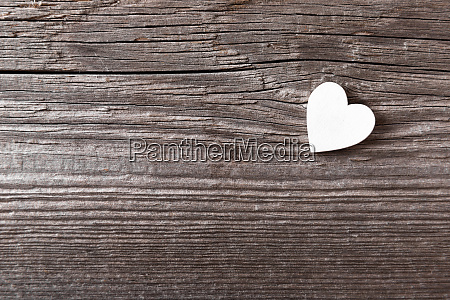 white heart on a wooden background
