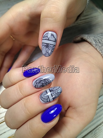 womens hands with a stylish manicure