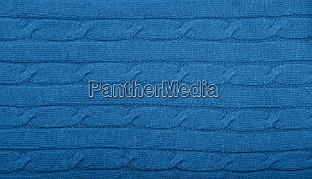 background of blue knitted wool fabric