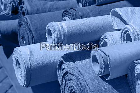 blue toned rolls of linen canvas