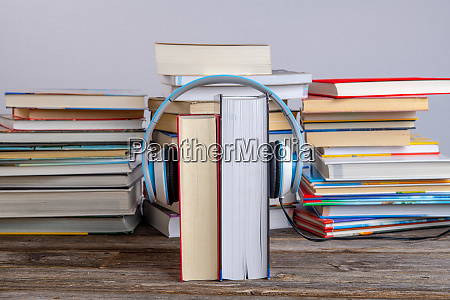 book with headphone in front of