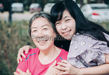 asian senior mother and her adult