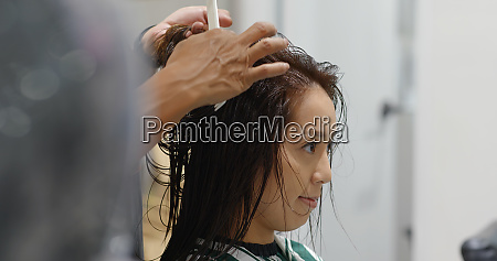 woman with hair cut at beauty
