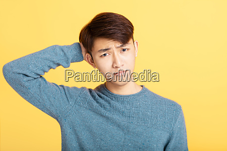 young man feeling sorry embarrassment concept