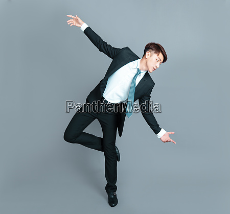 happy young business man dancing in