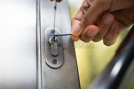 close up of male lockpicker fixing