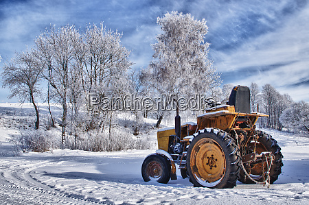winter sceneries in lithuania old tractor