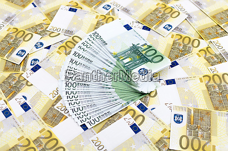 many euro banknotes making european currency