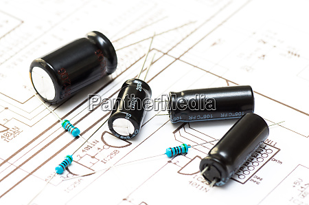 several capacitors and resistors placed on