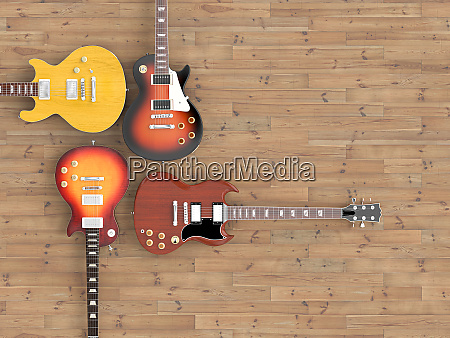 different guitars on wooden floors viewed