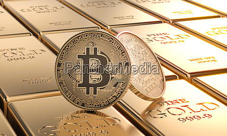 gold bitcoin coins laid on ingots