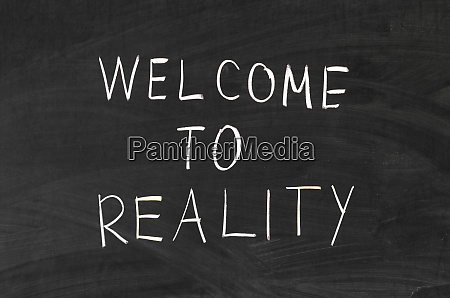 welcome to reality phrase handwritten on