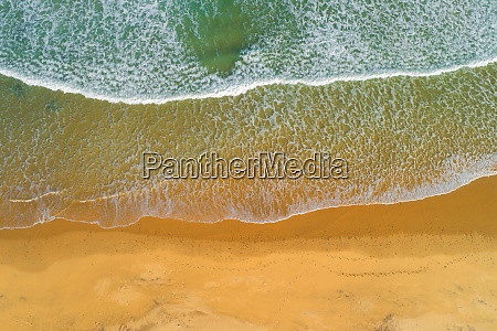 ocean waves on sandy beach