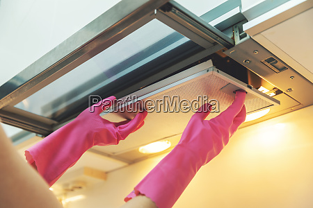 removing dirty cooker hood filter for