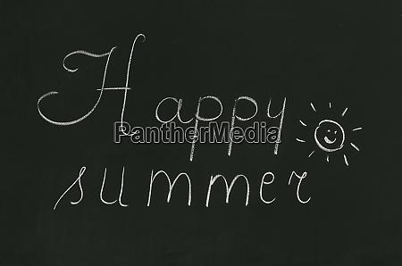 happy summer phrase handwritten on the