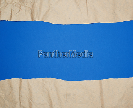 torn brown sheet of paper on