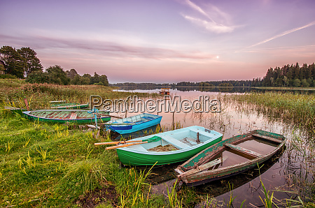 five old boats on the lake