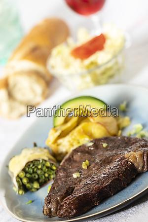 grilled steak with potato gratin