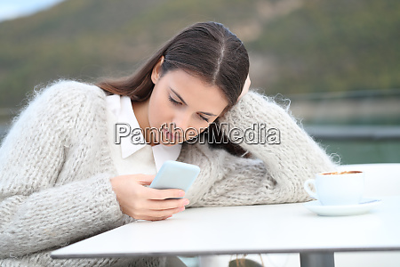 distracted girl using mobile phone in