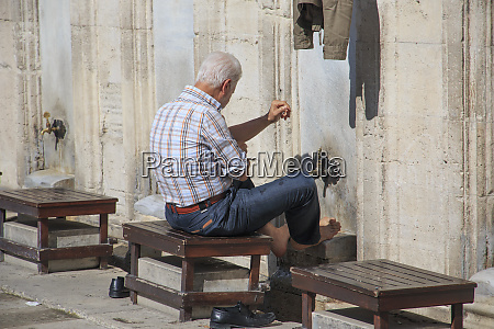 turkey istanbul man washing before prayers