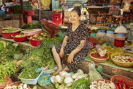 woman with produce stall at can