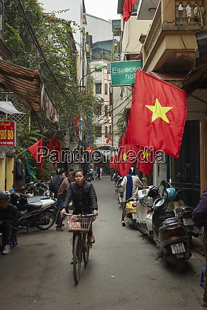 busy alley and vietnamese flags in