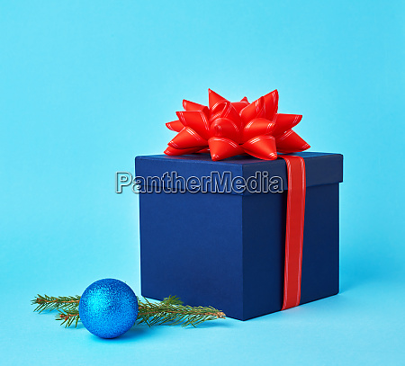 square blue cardboard box with a