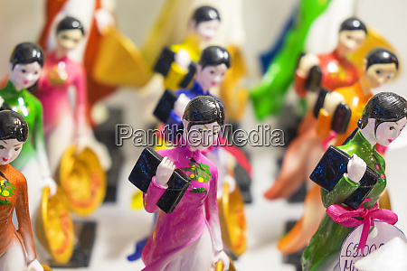 china figurines of young women in
