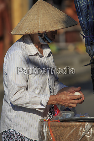 woman selling homemade delicacies on the