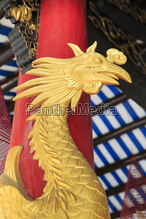 golden rooster on a pillar in