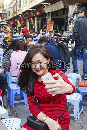 vietnam hanoi street cafe crowds young