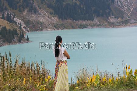 woman with trans ili alatau mountains
