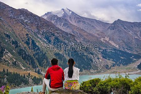 a couple by big almaty lake