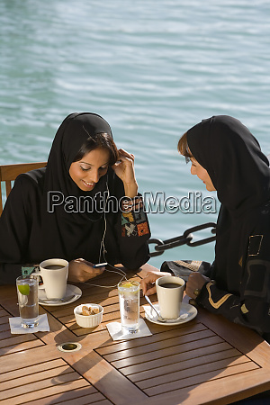 two women talking dubai united arab