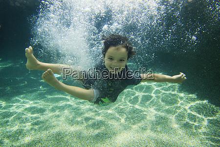 a backyard swimming pool is the
