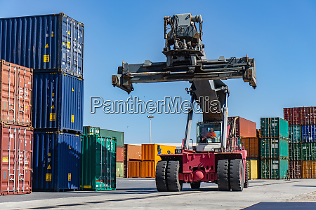 reach stacker and shipping containers in