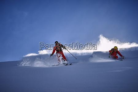 skiers skiing