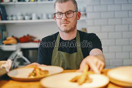 waiter placing food on service counter