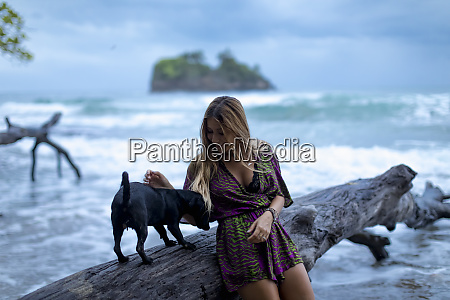 woman playing with pet dog on
