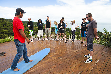 students learn the basics of surfing
