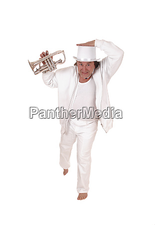 a trumpet player standing in a